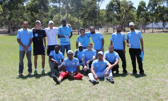 City Start participants with Melbourne City FC coaches after their first football training session.
