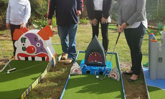 MatchWorks, Envision Employment Services and MAX Solutions team members with the Peninsula Sandtrap mini golf course.